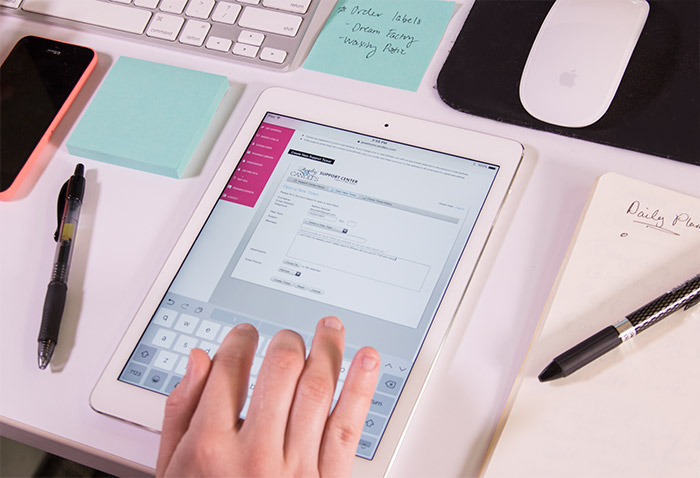 The customer support Module being used by an individual on an I-pad.